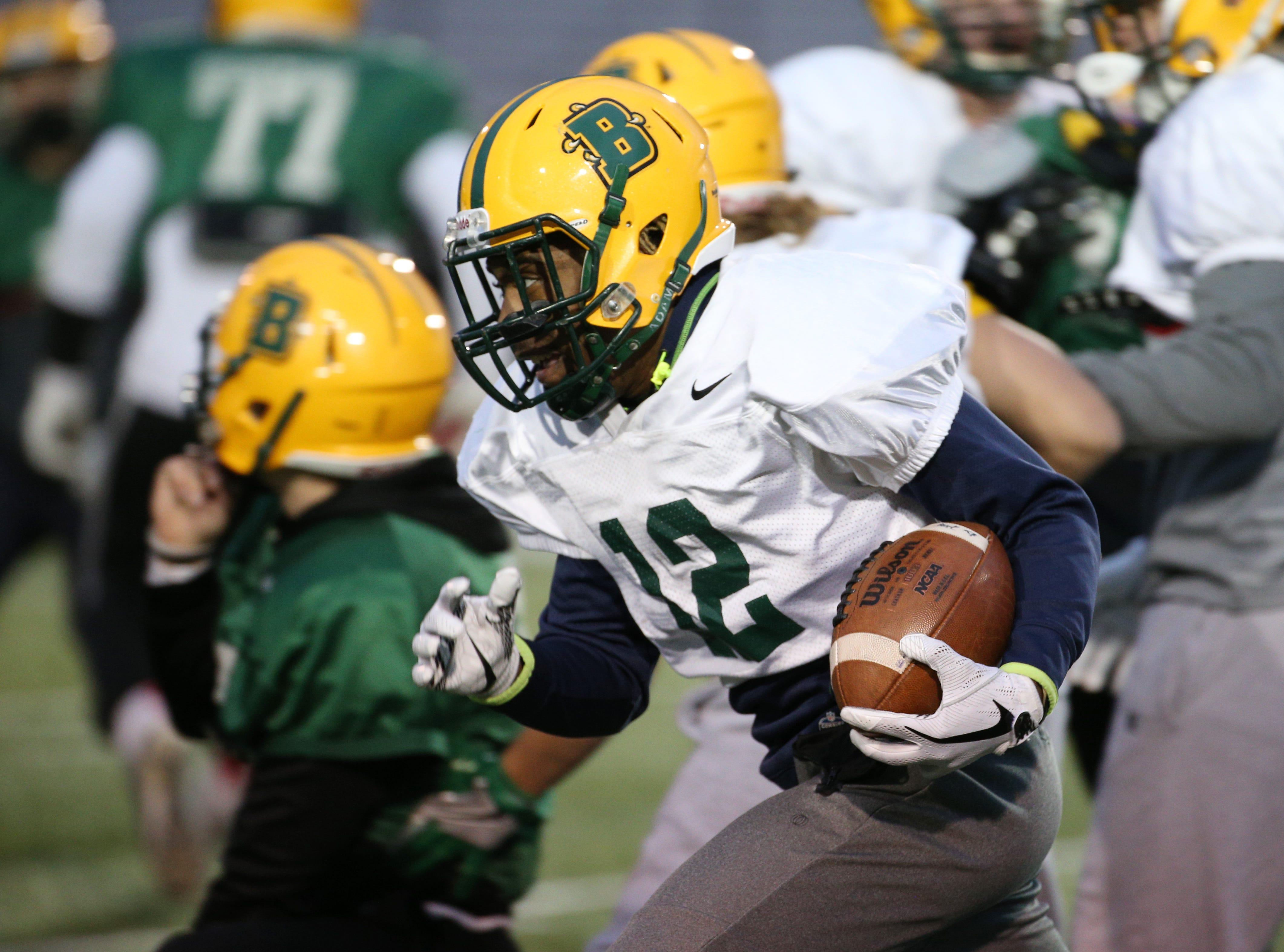 Freshman quarterback Keion Jones (12) at Brockport football practice.