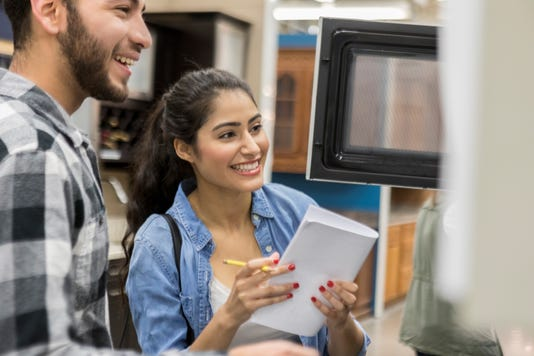 Young Couple Shop For Appliance For Their Home
