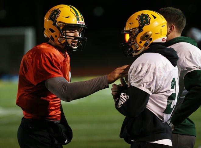 Joe Germinerio  (9) and Joseph Ortiz  (24) talk on the sidelines at a Brockport football practice.