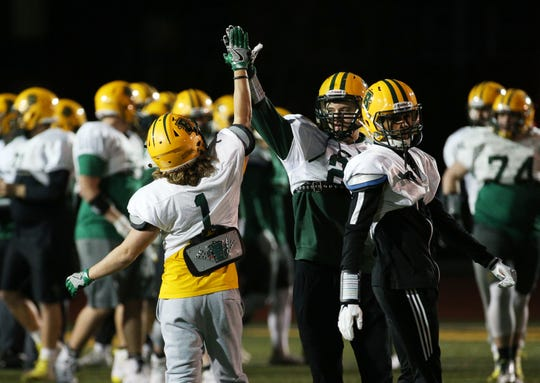 Christian Hollister (1) and Ben Damiani  (20) at Brockport football practice.