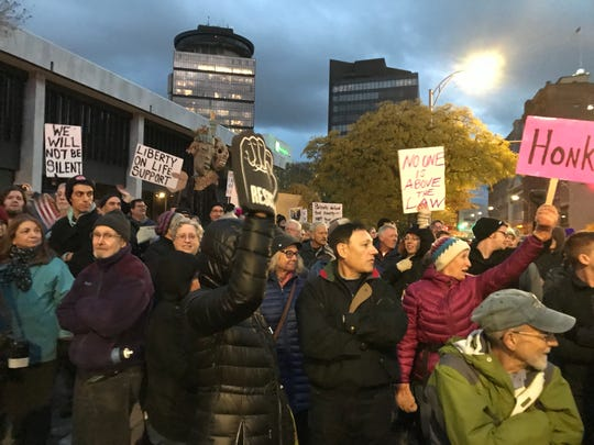 """We will not be silent,"" protesters said. They gathered Thursday to voice disdain for President Trump's dismissal of Attorney General Jeff Sessions."