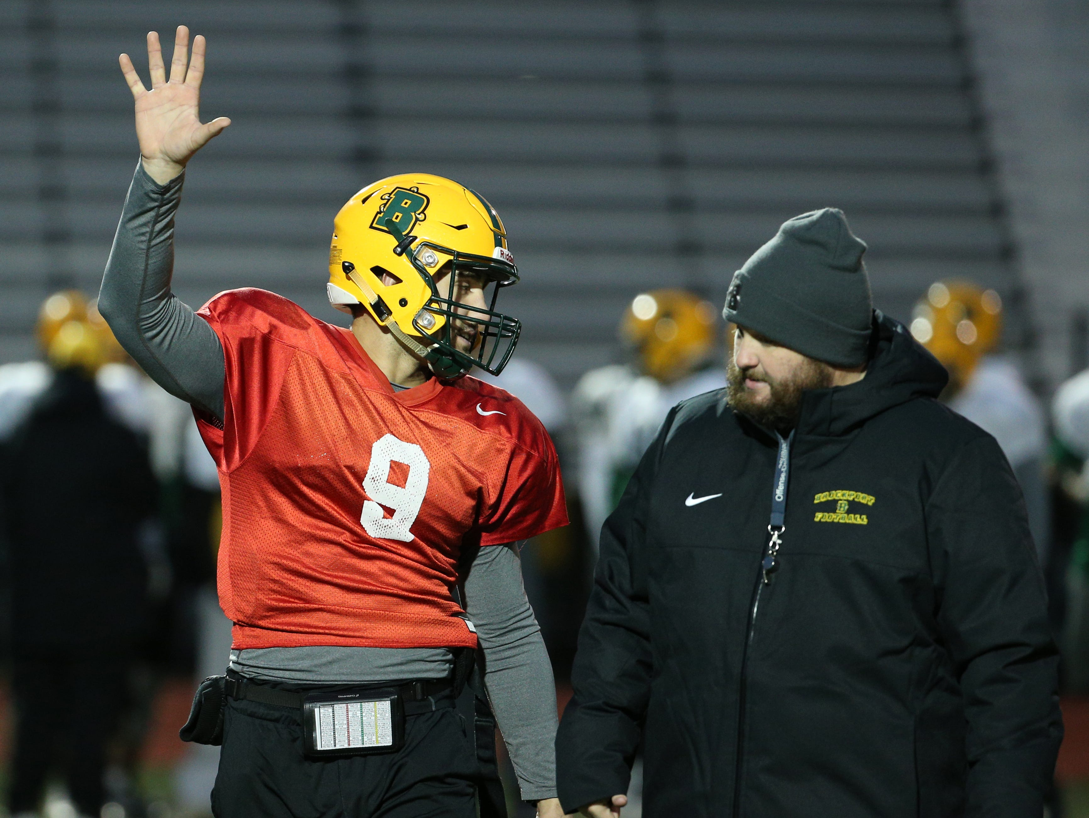 Joe Germinerio  (9) talks with assistant coach Justin Dueppengiesser at Brockport football practice.