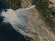 In this image provided by NASA's Earth Observing System Data and Information System (EOSDIS), smoke from the Camp Fire can seen spreading across northern California on Thursday, Nov. 8, 2018.