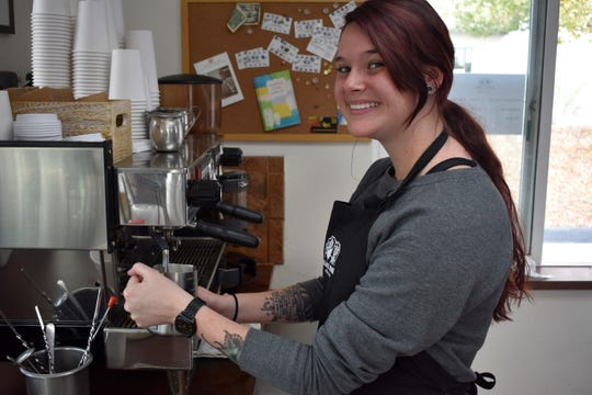 Cassidy Rosales makes a vanilla latte at Black Rose Coffee & Tea.