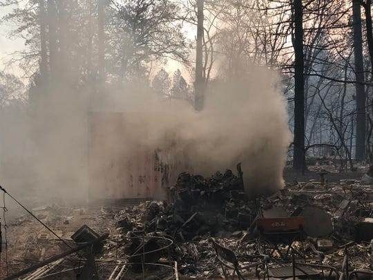 A Paradise home continued to smolder Friday morning after the Camp Fire destroyed the area.