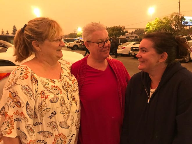 Paradise residents Nicole Jolly (right) her mother Heidi Jolly (center) and friend Karen Davis don't yet know if they lost their homes.
