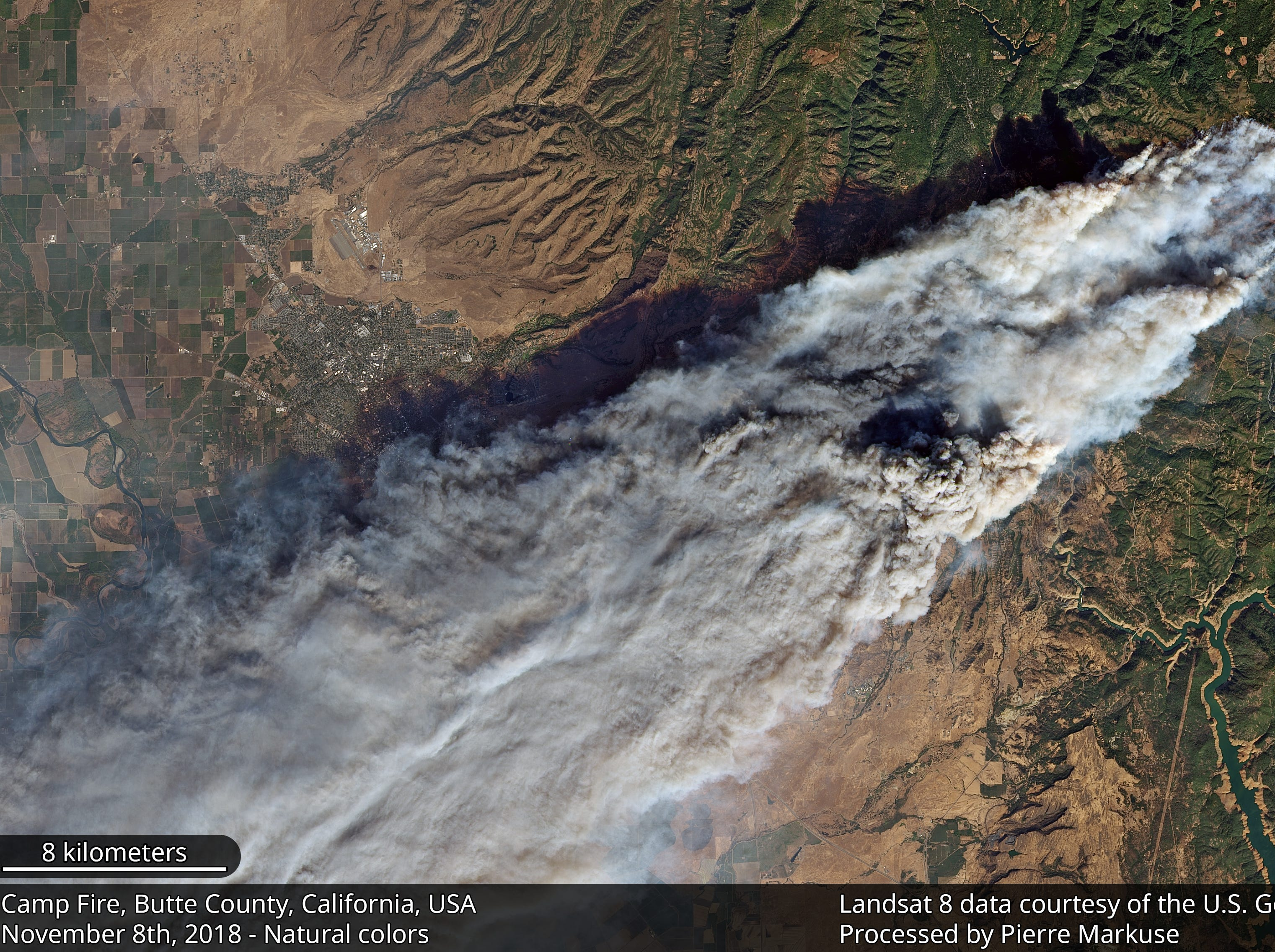 In this satellite image taken by NASA's Landsat 8, smoke from the Camp Fire can be seen stretching far beyond Butte County on Thursday, Nov. 8, 2018.