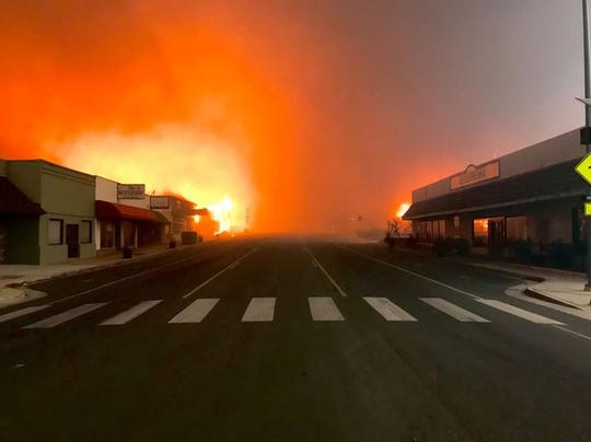 The Camp Fire roars Nov. 8, 2018, into Paradise, California, after evacuations empty the town.
