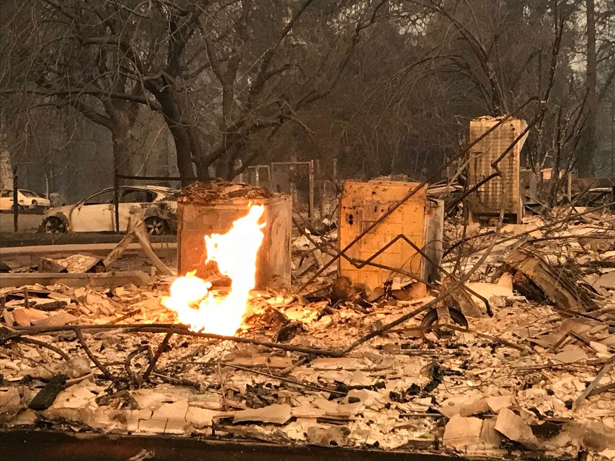 Flames still burned at this house on Friday after it was turned into rubble by the Camp Fire on Friday.