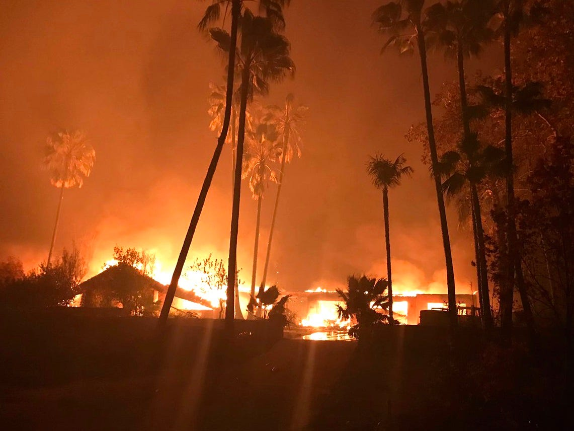 Homes burn on Spanish Garden Drive east of Chico on Thursday night as the Camp Fire rages out of control.