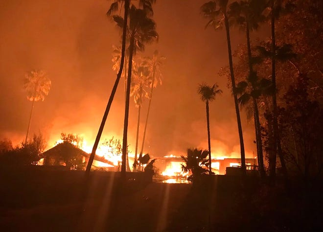 Homes burn on Spanish Garden Drive east of Chico last year as the Camp Fire raged out of control.