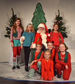 "Susan (Makena Pohrman, in blue top) is one of the few who believe Kris Kringle (David Cutler) is the real Santa Claus. ""Miracle on 34th Street"" opens Friday at Riverfront Playhouse."