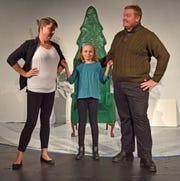 Doris Walker (Kris Dickey), left, has told her daughter Susan (Makena Pohrman) not to believe in Santa Claus but friend Fred Gayley (Aaron Steinmetz) feels otherwise.
