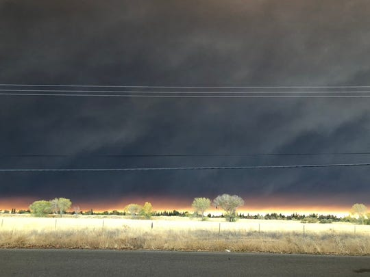 View of the Camp Fire burning in Paradise from Thorntree Drive near Chico Airport