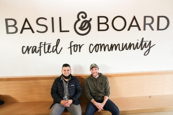 Partners Conrad Venti and Brian Kaufman (left to right) are pictured at the location of their newest venture, Basil & Board, in downtown Salem on Friday, Nov. 9, 2018. The restaurant is set to open soon.