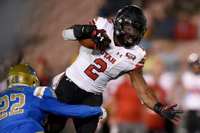 Oct 26, 2018; Pasadena, CA, USA; Utah Utes running back Zack Moss (2) runs the ball defended by UCLA Bruins defensive back Nate Meadors (22) during the second half at Rose Bowl. Mandatory Credit: Kelvin Kuo-USA TODAY Sports