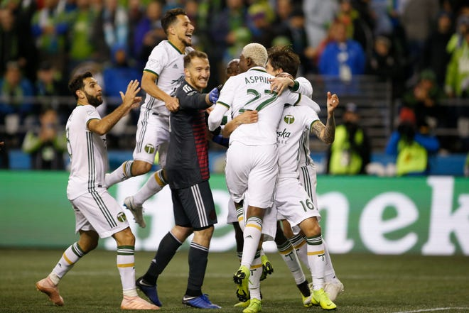 The Portland Timbers celebrate after a win over the Seattle Sounders FC during penalty kicks at CenturyLink Field.