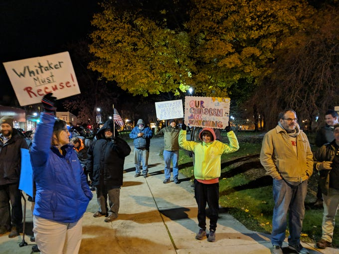 Protesters stand on the corner of Erie Avenue and North Ninth Street in Sheboygan on Thursday,  Nov. 8 to protest the replacement of Jeff Sessions with Matthew Whitaker. Around 40 people came out to the protest.