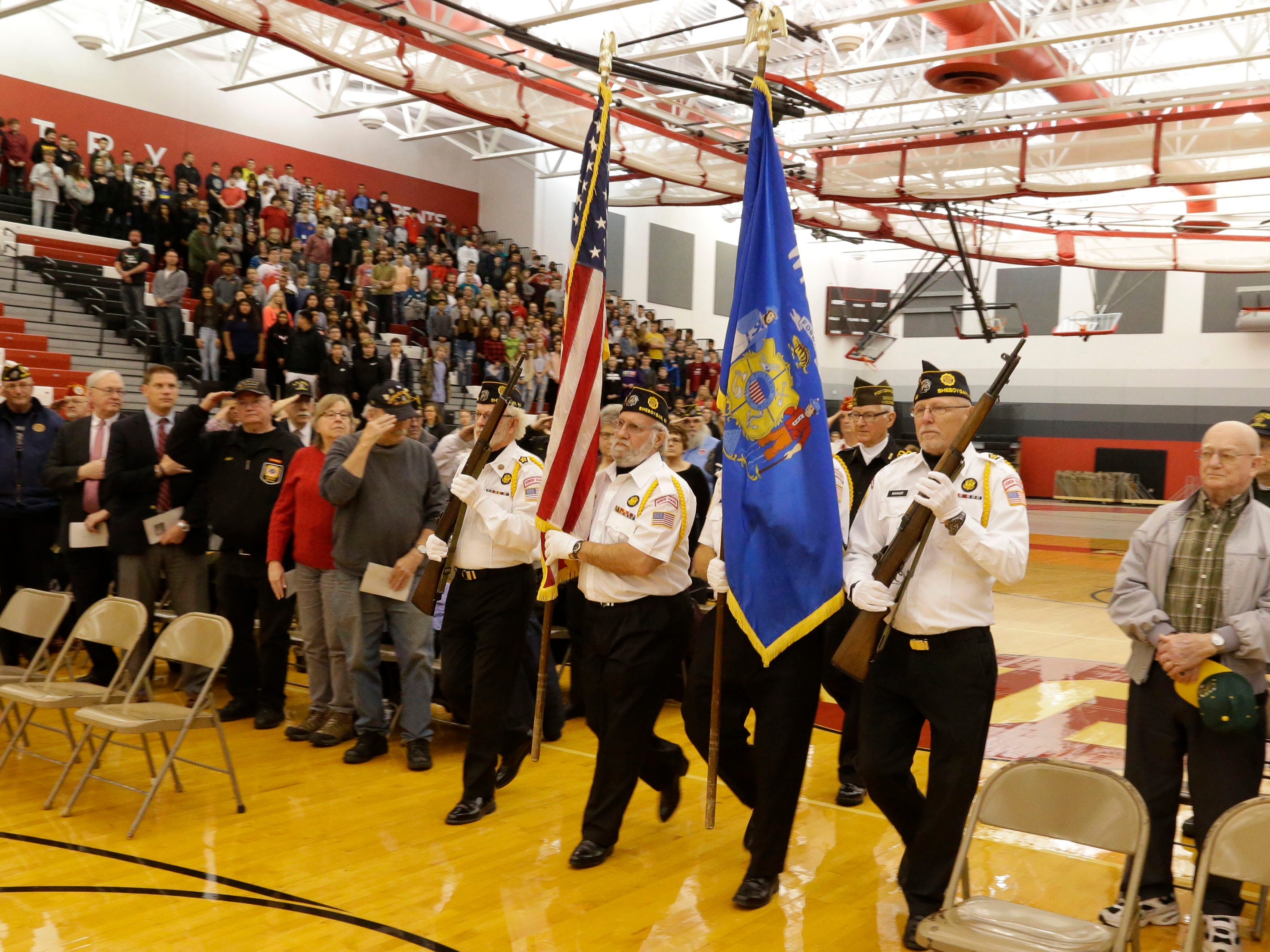 Members of Sheboygan Memorial Post 9156 carry the colors during the Veterans Day Program at Sheboygan South High School, Friday, November 9, 2018, in Sheboygan, Wis.