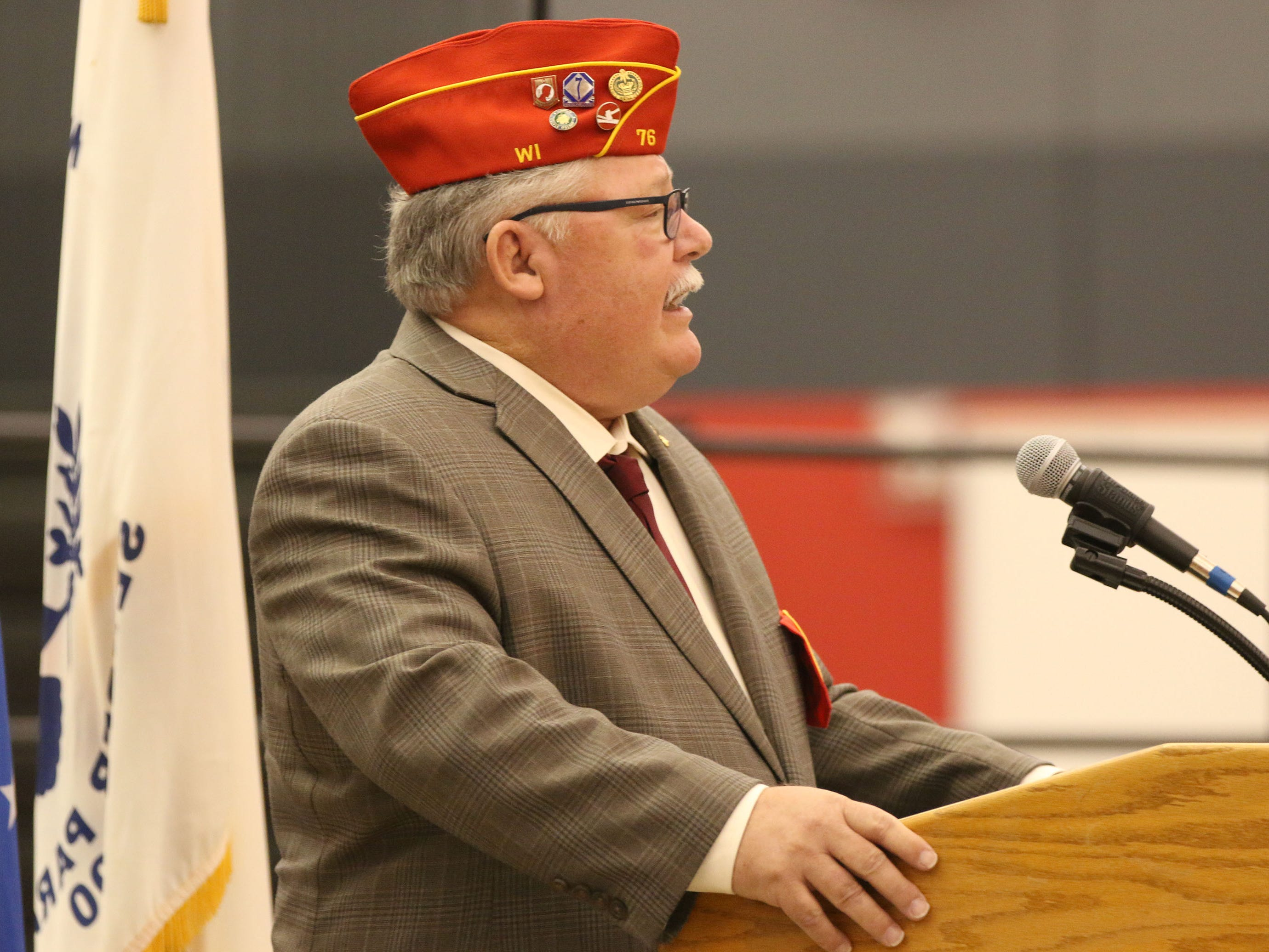 Mike Liebelt of the Retired Enlisted Association, Chapter 76, of Sheboygan speaks during the Veterans Day Program held at Sheboygan South High School, Friday, November 9, 2018, in Sheboygan, Wis.