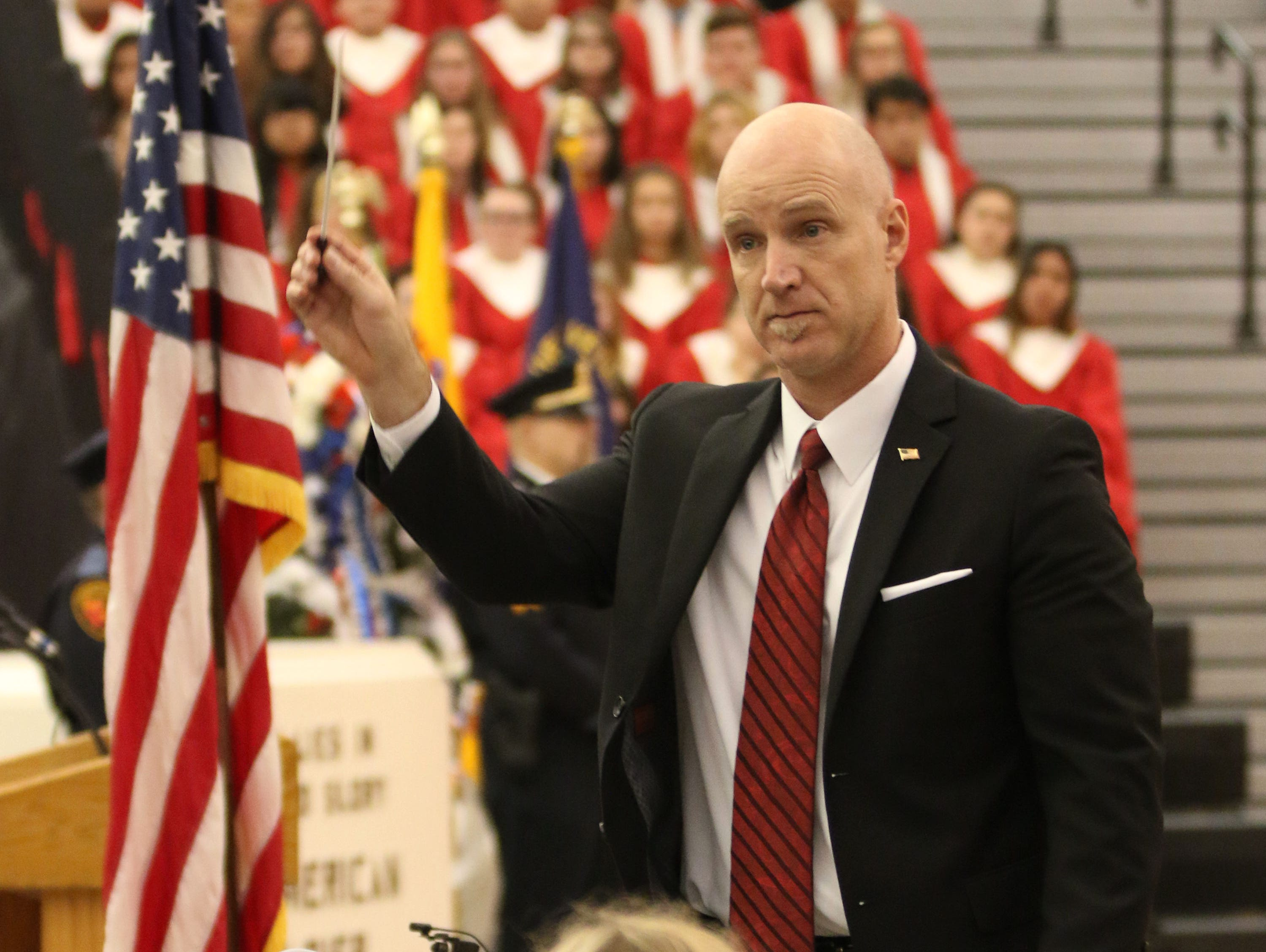 Sheboygan South band director Wade Heinen directs the American Salute during the Veterans Day Program at Sheboygan South High School, Friday, November 9, 2018, in Sheboygan, Wis.
