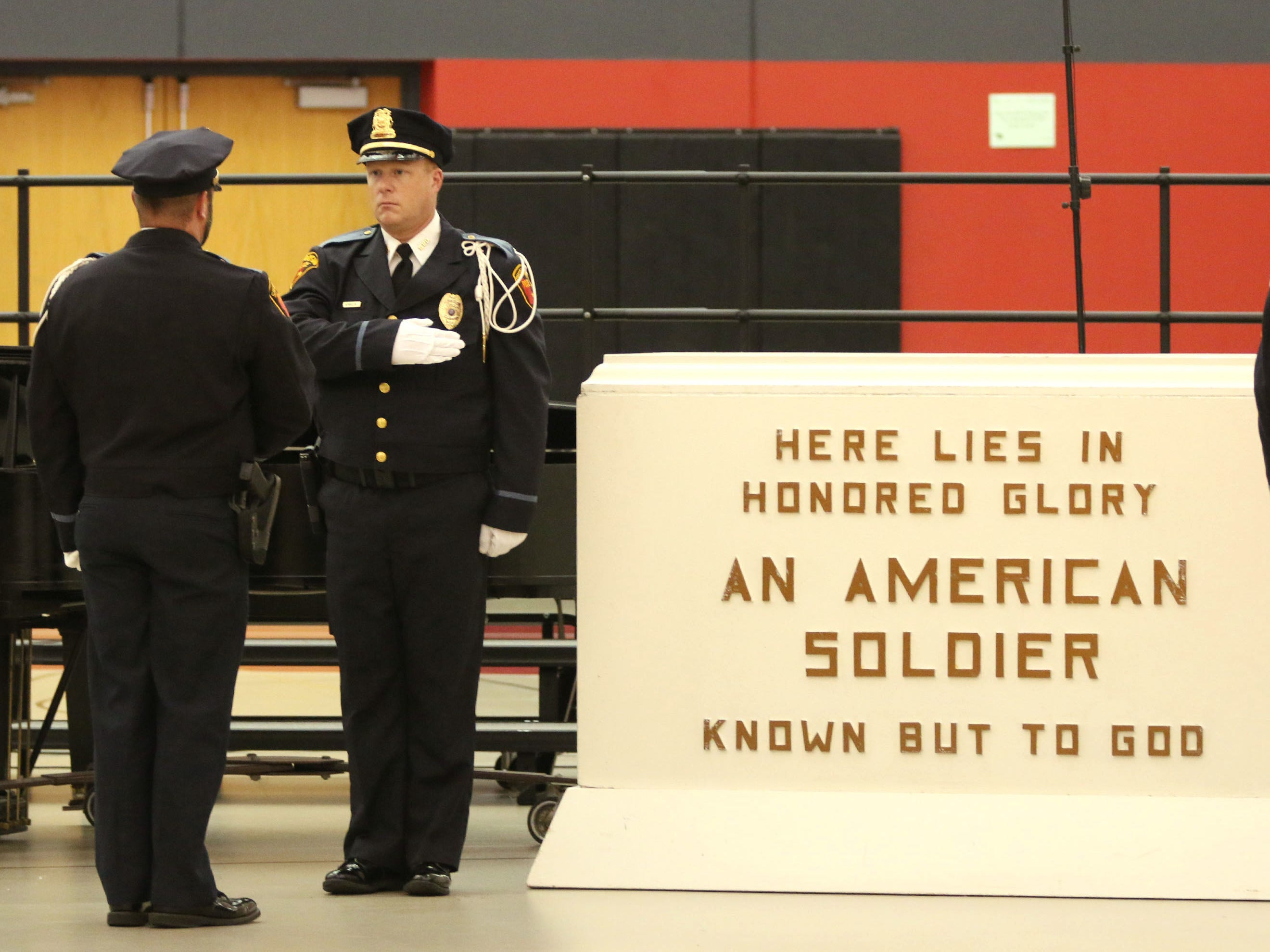 The changing of the guard at the Tomb of the Unknown Soldier during the Veterans Day Program at Sheboygan South High School,Friday, November 9, 2018, in Sheboygan, Wis.