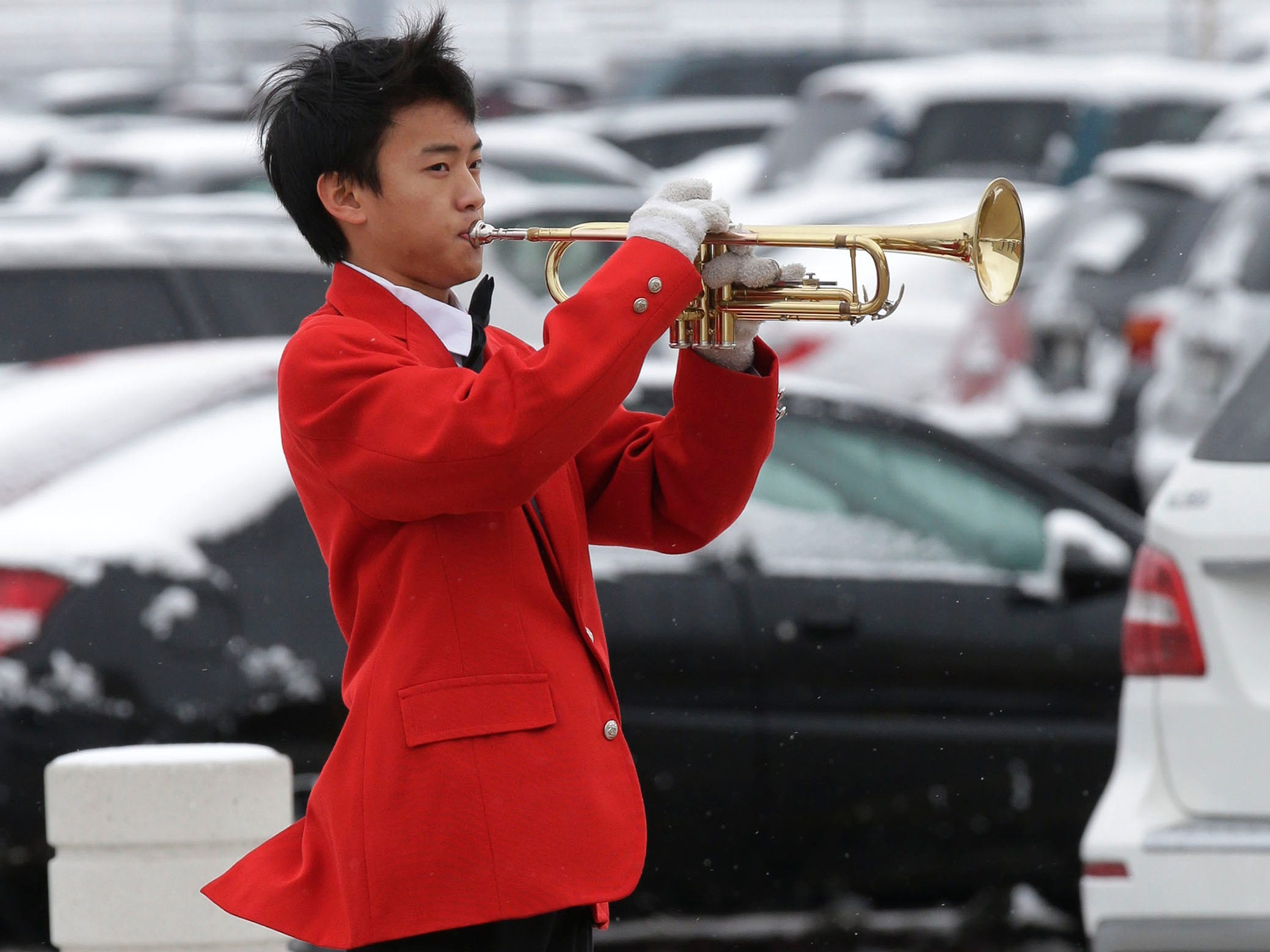 Kong Meng Yang performs Taps at the end of the Sheboygan South Veterans Day program, Friday, November 9, 2018, in Sheboygan, Wis.