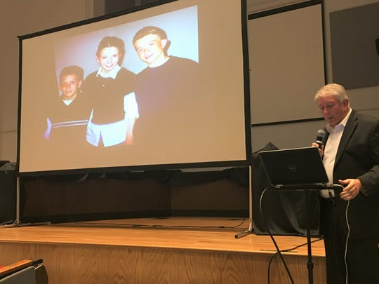 Darrell Scott speaks at the Bossier Instructional Center on Nov. 8, 2018. Pictured on the screen are three of his children, including Rachel, center, who died in the Columbine High School shooting in 1999.