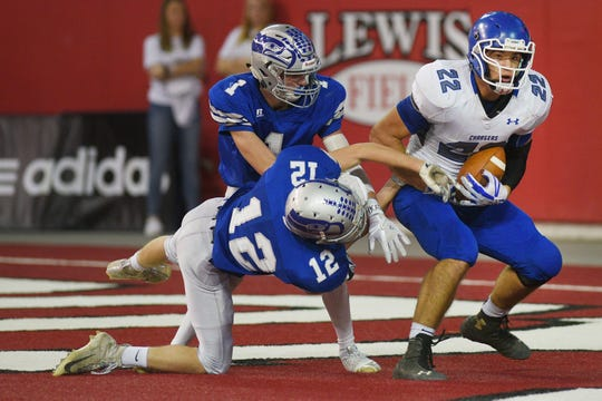 Sioux Falls Christian's Mitchell Goodbary completes a pass in the end zone scoring a touchdown against Bridgewater-Emery/Ethan in the 11B Championships Friday, Nov. 9, at the DakotaDome in Vermillion.