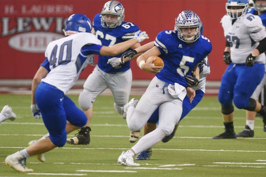 Bridgewater-Emery/Ethan's Brady Hawkins runs the ball during the game against Sioux Falls Christian in the 11B Championships Friday, Nov. 9, at the DakotaDome in Vermillion.