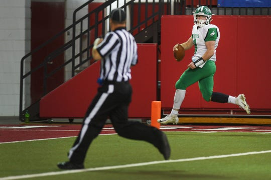 Colome's Jackson Kinzer looks back before he scores a touchdown against Sully Buttes in the 9B Championships Friday, Nov. 9, at the DakotaDome in Vermillion.