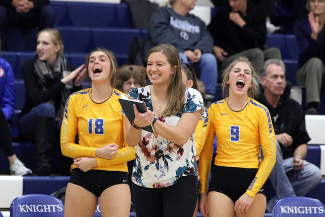 O'Gorman volleyball coach Emily Byrnes celebrates a point with her team during a match against Lincoln in 2018.
