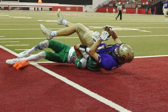 Sully Buttes' Grant Johnson scores a touchdown against Colome's Layton Thieman in the 9B Championships Friday, Nov. 9, at the DakotaDome in Vermillion.