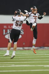 Dell Rapids' Drew Van Regenmorter (52) and Colin Rentz (3) takes the field for the game against Tea Area Thursday, Nov. 8, in the 11A Championships at the DakotaDome in Vermillion.