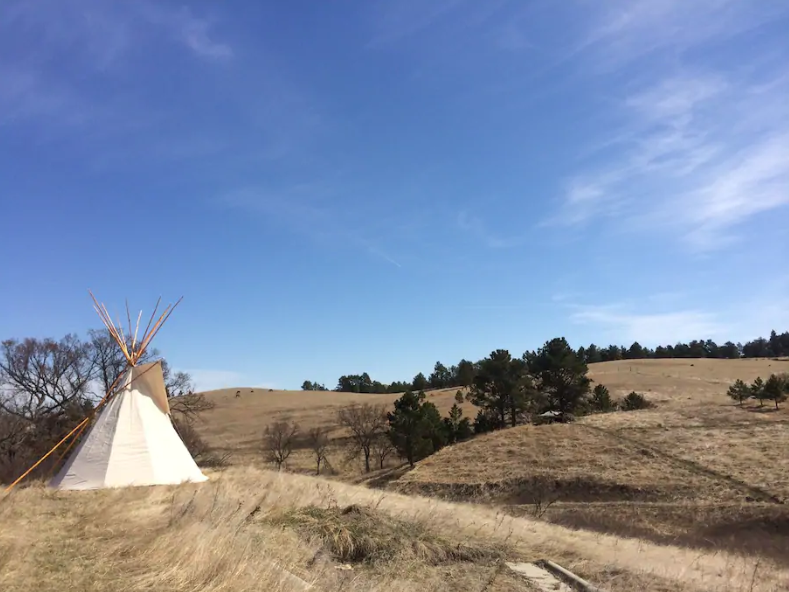 The meadow allowing for tents and tipi rentals such as the Tipi on the Prairie is less than 10 miles from the Wounded Knee Massacre Site on the Pine Ridge Reservation.
