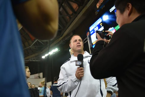 Tea Area head coach Craig Clayberg gives interviews after the win against Dell Rapids Thursday, Nov. 8, in the 11A Championships at the DakotaDome in Vermillion.