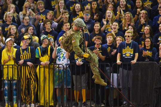 Tea Area's student section watches the pregame show before the game against Dell Rapids Thursday, Nov. 8, in the 11A Championships at the DakotaDome in Vermillion.