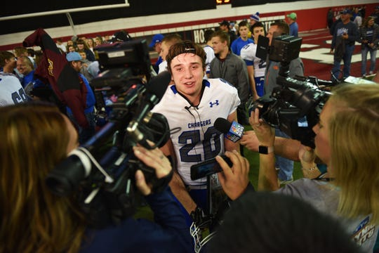 Sioux Falls Christian's Parker Nelson gives interviews after the win against Bridgewater-Emery/Ethan in the 11B Championships Friday, Nov. 9, at the DakotaDome in Vermillion.