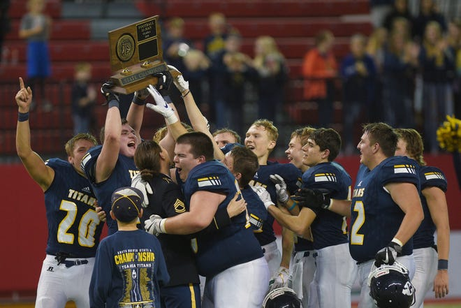 Tea Area walks up to accept the class A championship trophy after the win against Dell Rapids Thursday, Nov. 8, in the 11A Championships at the DakotaDome in Vermillion.