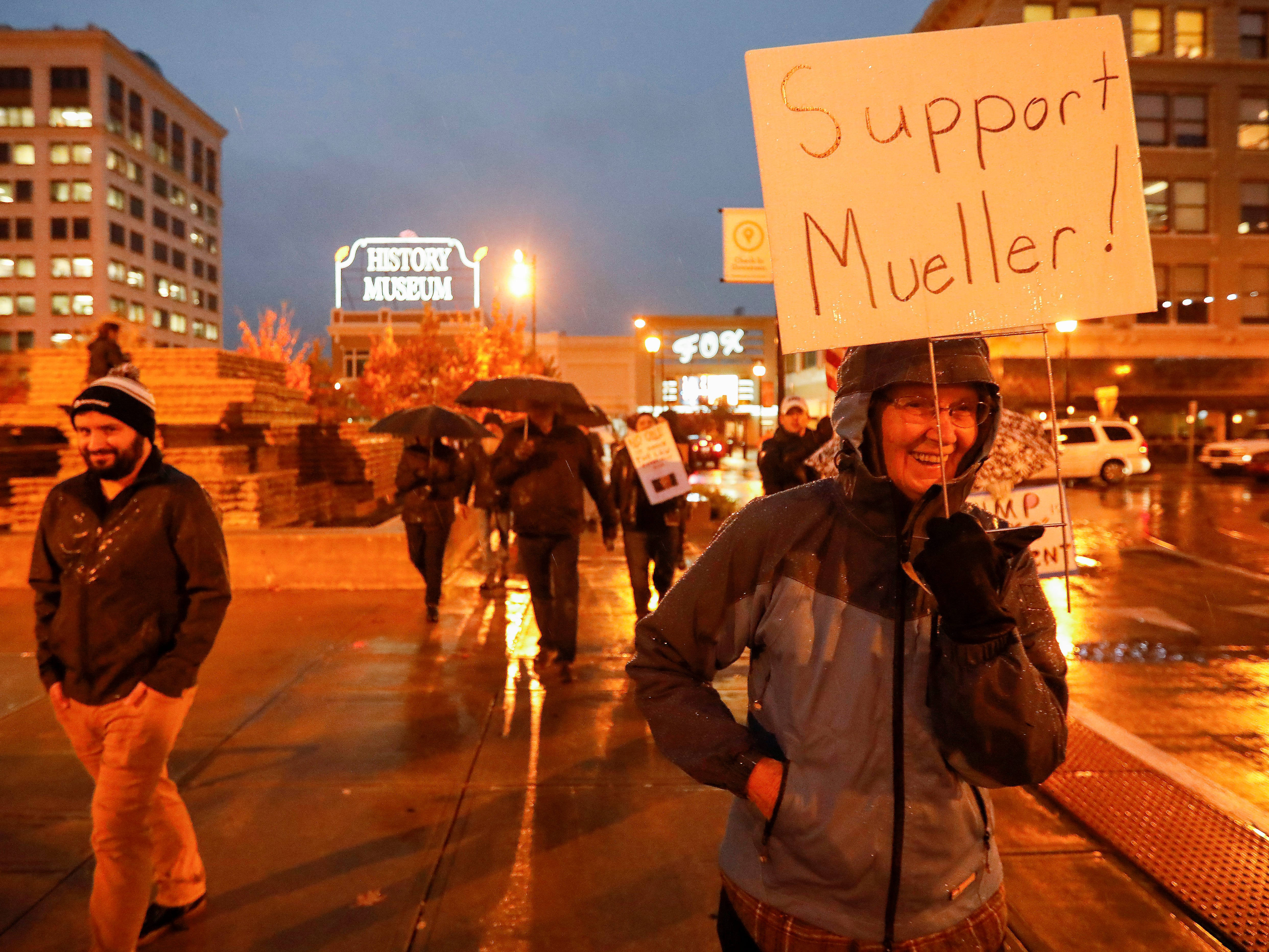 About 50 people carried umbrellas and protest signs as they marched around Park Central Square on Thursday, Nov. 8, 2018. The group was calling for new Acting Attorney General Matt Whitaker to recuse himself from Robert Mueller's investigation into Russian interference in the 2016 election.