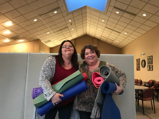 Pictured are Sherry Bowman and Nancy Crawford, the volunteer coordinator for the women's emergency shelter. This photo was taken the first night the shelter was open. It was then housed at Council of Churches. Later, the shelter moved to Grace United Methodist Church.