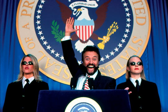 Yakov Smirnoff includes a set where he takes questions from the audience while playing the role of White House spokesman.