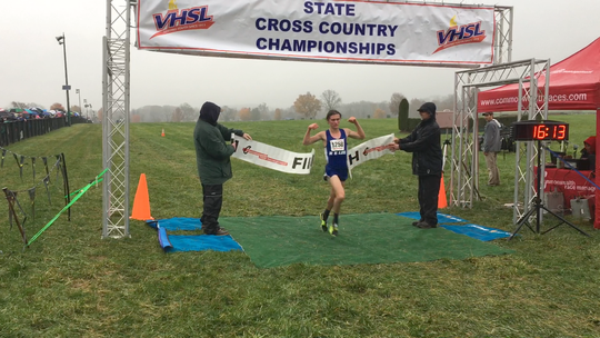 Robert E. Lee's Oliver Wilson-Cook cross the finish line to win the Class 2 boys race at the VHSL Cross Country Championships on Friday, Nov. 9, 2018, at Great Meadow in The Plains, Va.