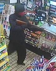 Surveillance footage shows one of two suspects robbing a 7-Eleven in Harrisonburg on Tuesday.