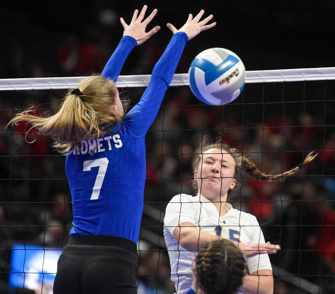 Cathedral's Gabby Heying gets a shot past McKenzie Evans of Kasson-Mantorville during the first game of the state Class 2A quarterfinals Thursday, Nov. 8, at the Xcel Energy Center in St. Paul.