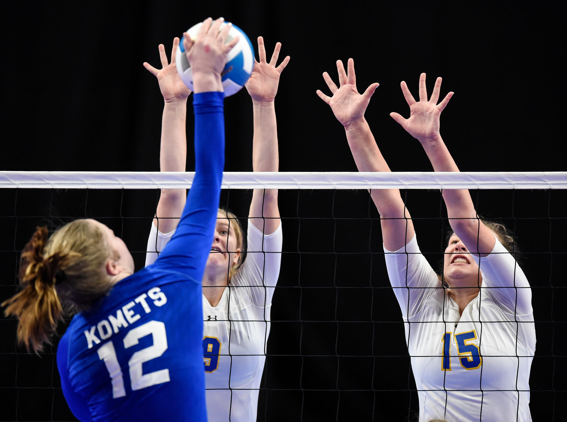 Meg Januschka and Gabby Heying leap for a block for Cathedral during the state Class 2A quarterfinals Thursday, Nov. 8, at the Xcel Energy Center in St. Paul.