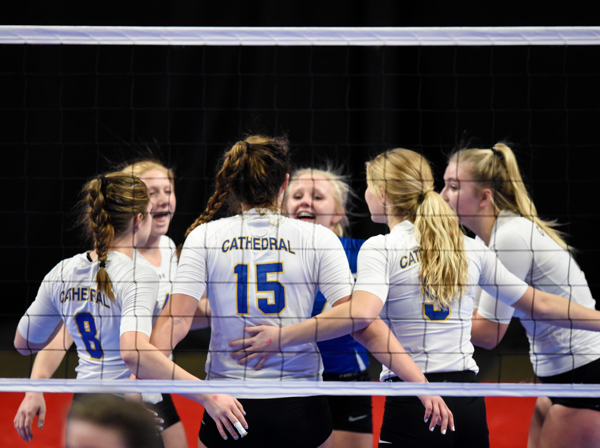 Cathedral players celebrate a point during the state Class 2A quarterfinals Thursday, Nov. 8, at the Xcel Energy Center in St. Paul.