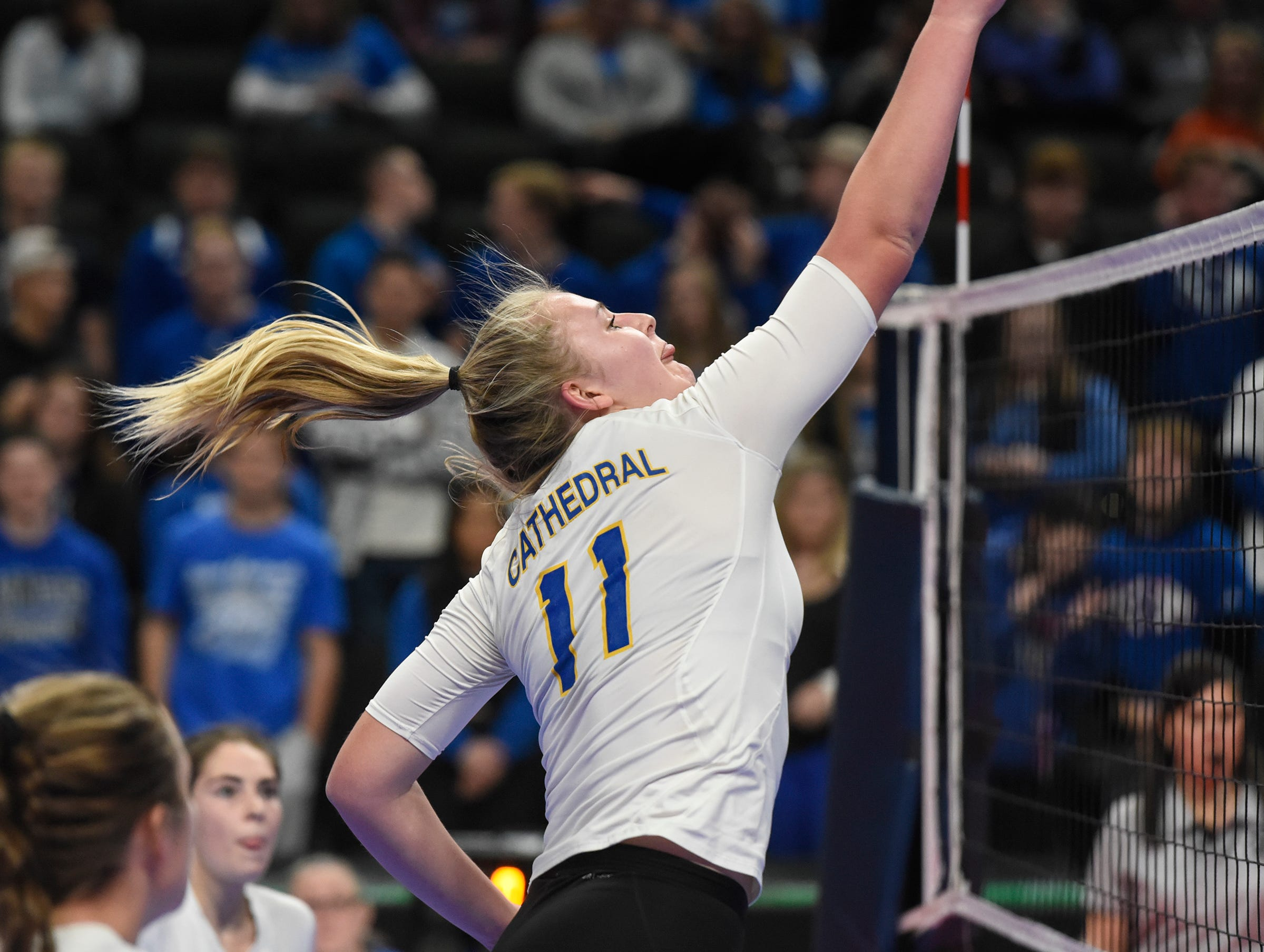 Cathedral's Hallie Hupf hits high over the net during the state Class 2A quarterfinals Thursday, Nov. 8, at the Xcel Energy Center in St. Paul.