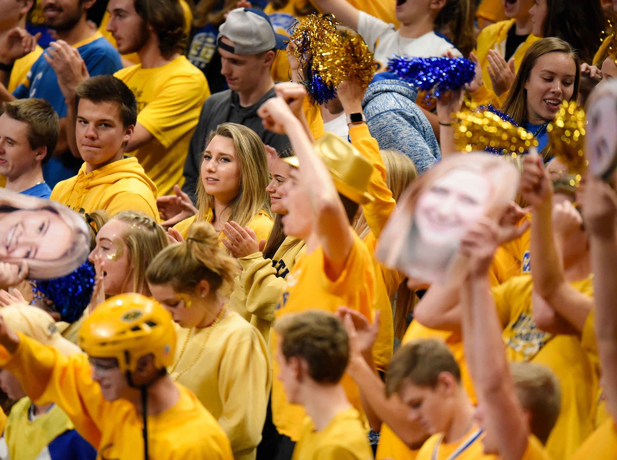 Cathedral fans cheer for their team during the state Class 2A quarterfinals Thursday, Nov. 8, at the Xcel Energy Center in St. Paul.