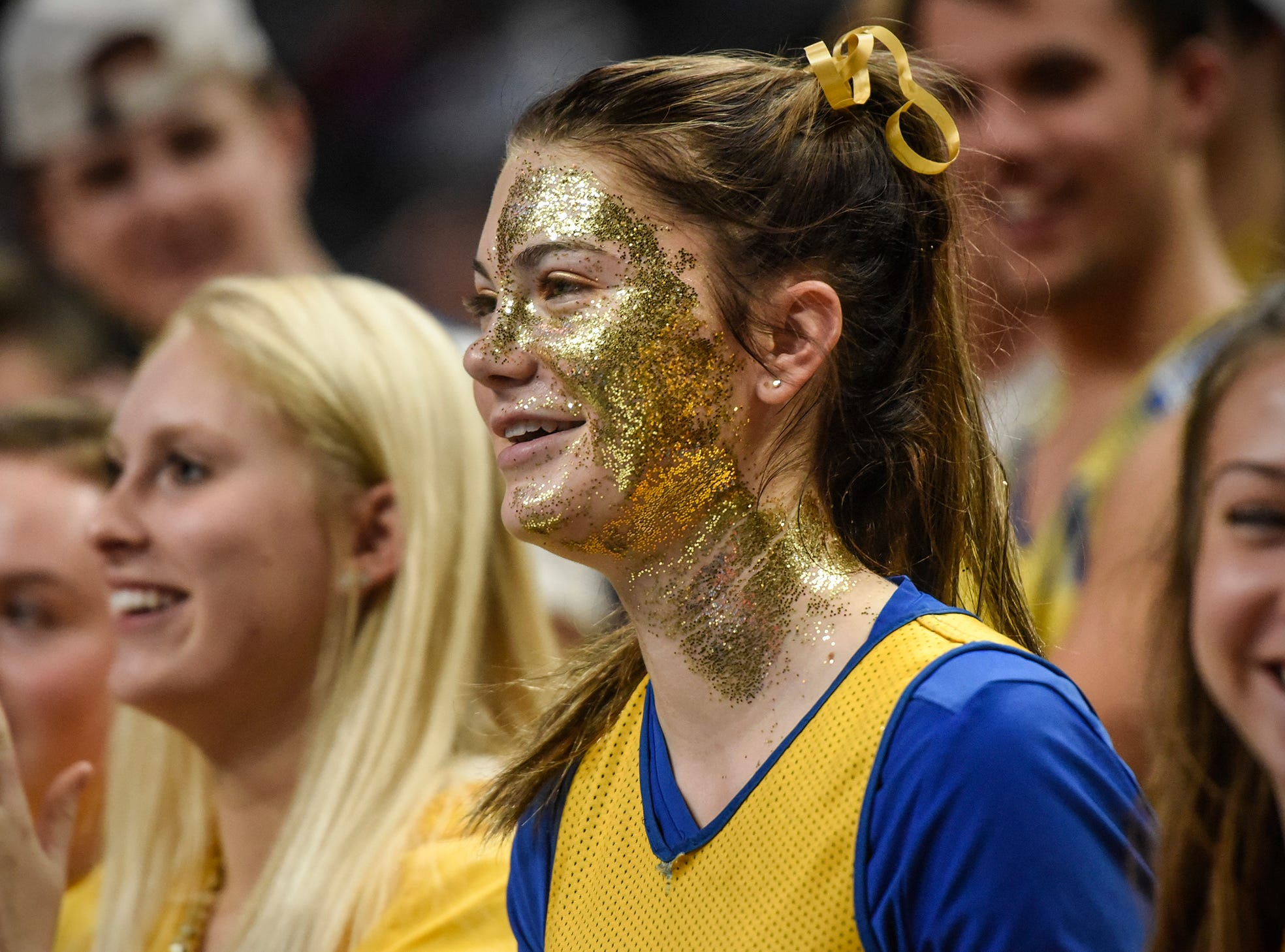 Madelyn Bauerly is decked out in gold glitter in the Cathedral student section during the state Class 2A quarterfinals Thursday, Nov. 8, at the Xcel Energy Center in St. Paul.